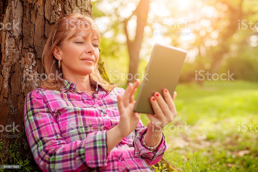Woman using digital tablet stock photo
