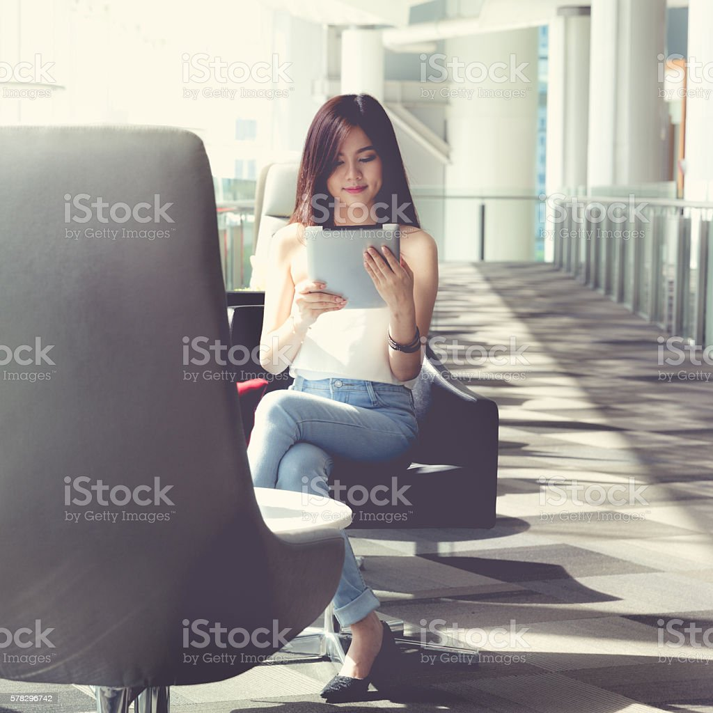 woman using digital tablet stock photo