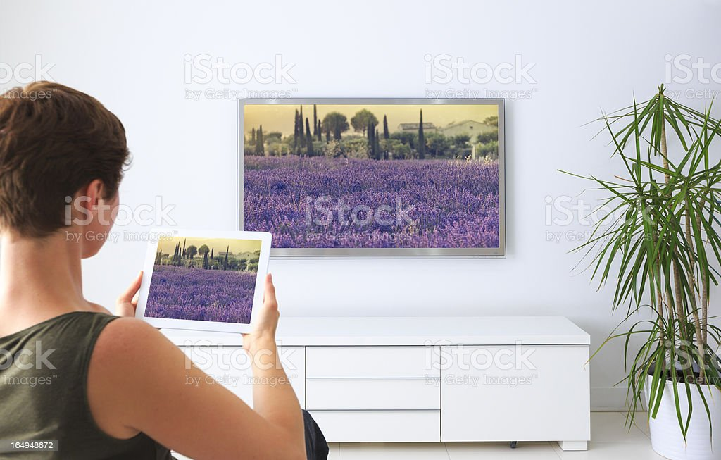 Woman using digital tablet to watch photographs royalty-free stock photo