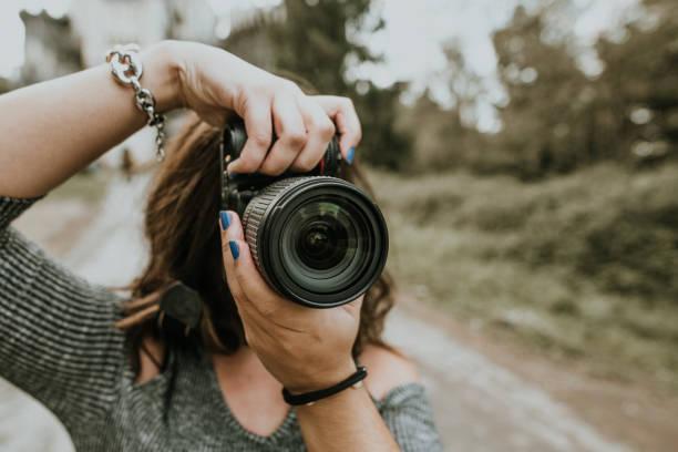 Woman using dslr camera picture id869706568?b=1&k=6&m=869706568&s=612x612&w=0&h=x0vtbg3fnid0ldm2jdnuk7m7bto51mrzphid2kjgoww=