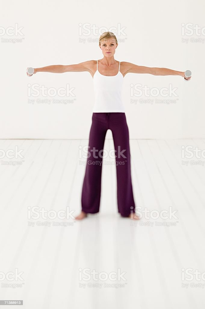 Woman using dumbbells royalty-free stock photo