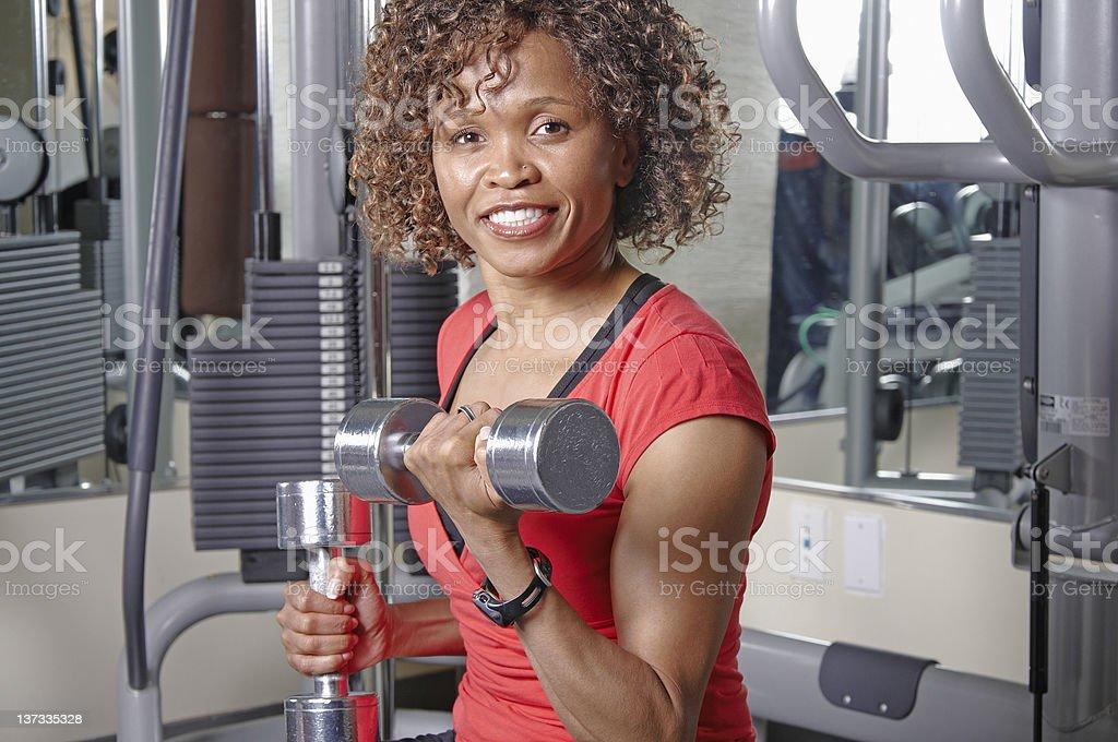 Woman using dumbells stock photo