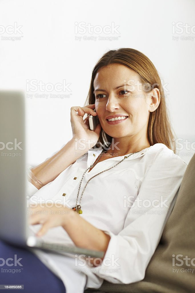 Woman using electronic gadgets royalty-free stock photo
