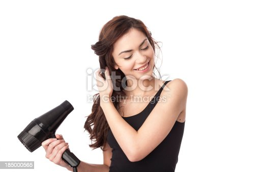 istock woman using hair drayer 185000565