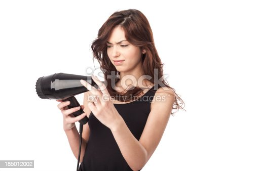 istock woman using hair drayer 185012002
