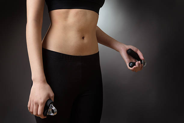 woman using hand grip - hand grip stock photos and pictures