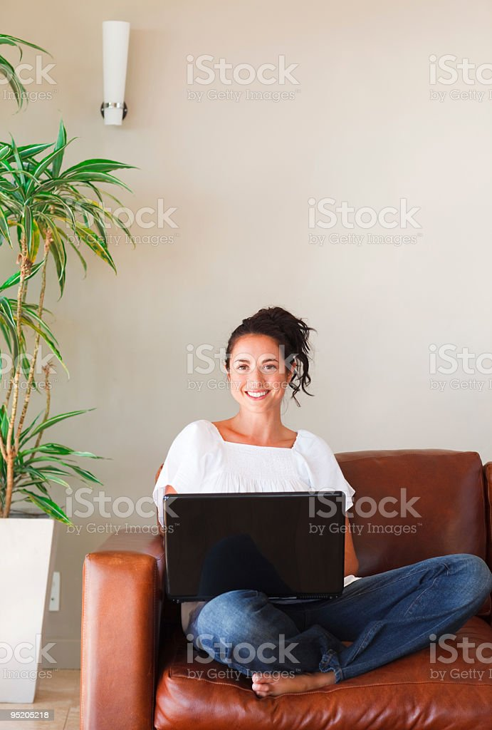 Woman using her laptop royalty-free stock photo
