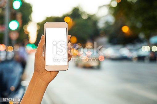 istock Woman Using her Mobile Phone Night Light Background 577974110