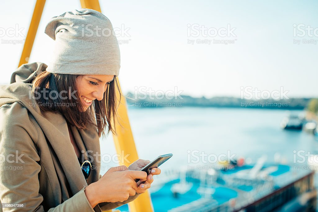 Woman using her mobile phone stock photo