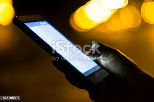 621574390 istock photo Woman using her mobile phone 698195924