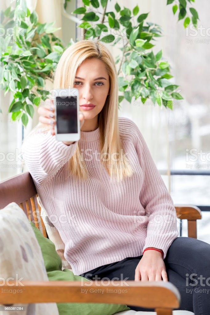 Woman using her Mobile Phone royalty-free stock photo