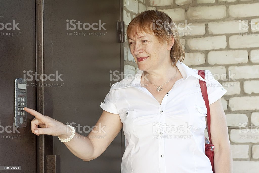 woman using house intercom stock photo