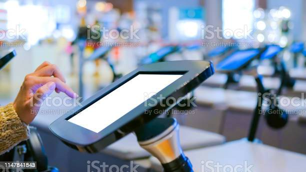 Woman using interactive touchscreen kiosk with white empty screen picture id1147841843?b=1&k=6&m=1147841843&s=612x612&h=mauho9bhy9kcjrnnkqcr2plys6yrvjfn gg9n3olcps=