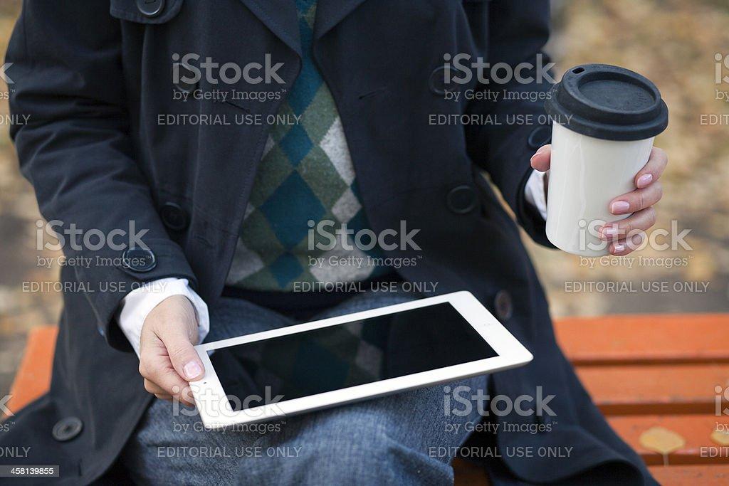 Woman using iPad royalty-free stock photo