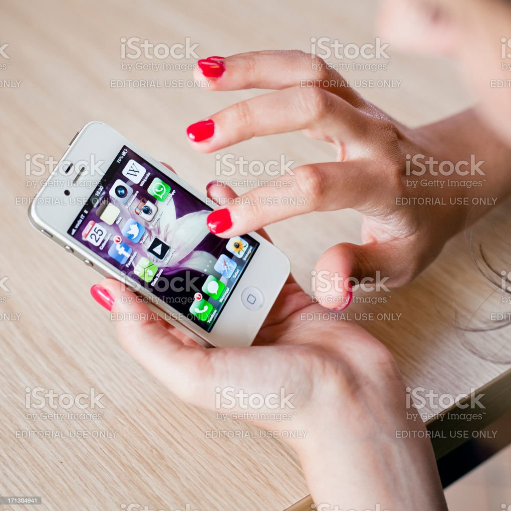 Woman using Iphone4 royalty-free stock photo