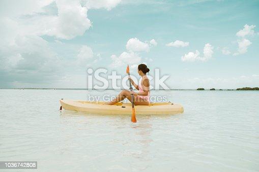 istock Woman using kayak in Bacalar 1036742808
