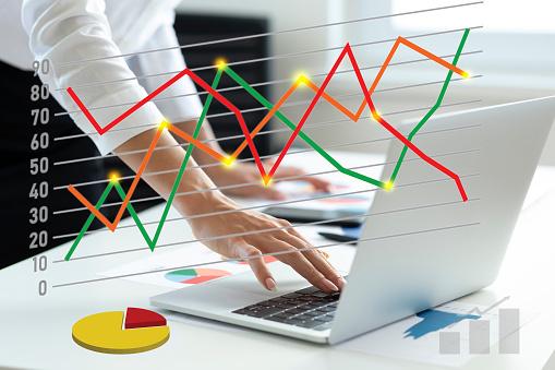 1025744818 istock photo Woman using laptop analyzing sales data 1266025336