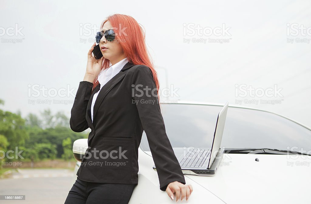 woman using laptop and mobile phone royalty-free stock photo
