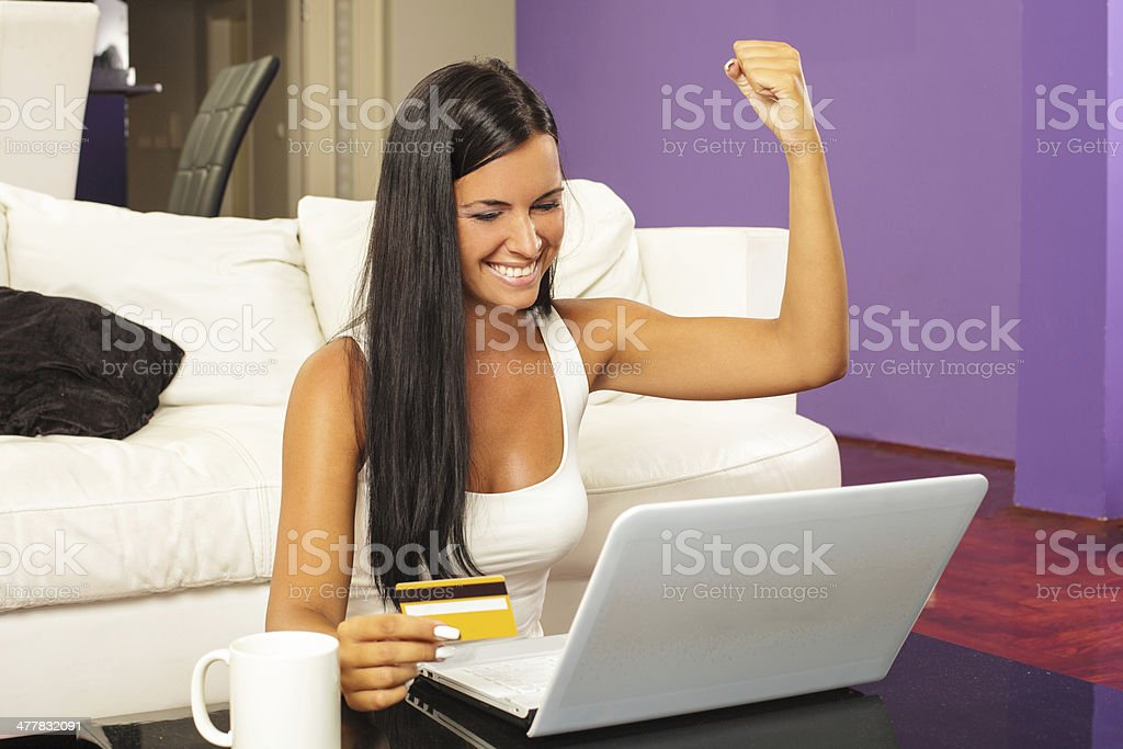 Woman using laptop and shopping online with credit card royalty-free stock photo
