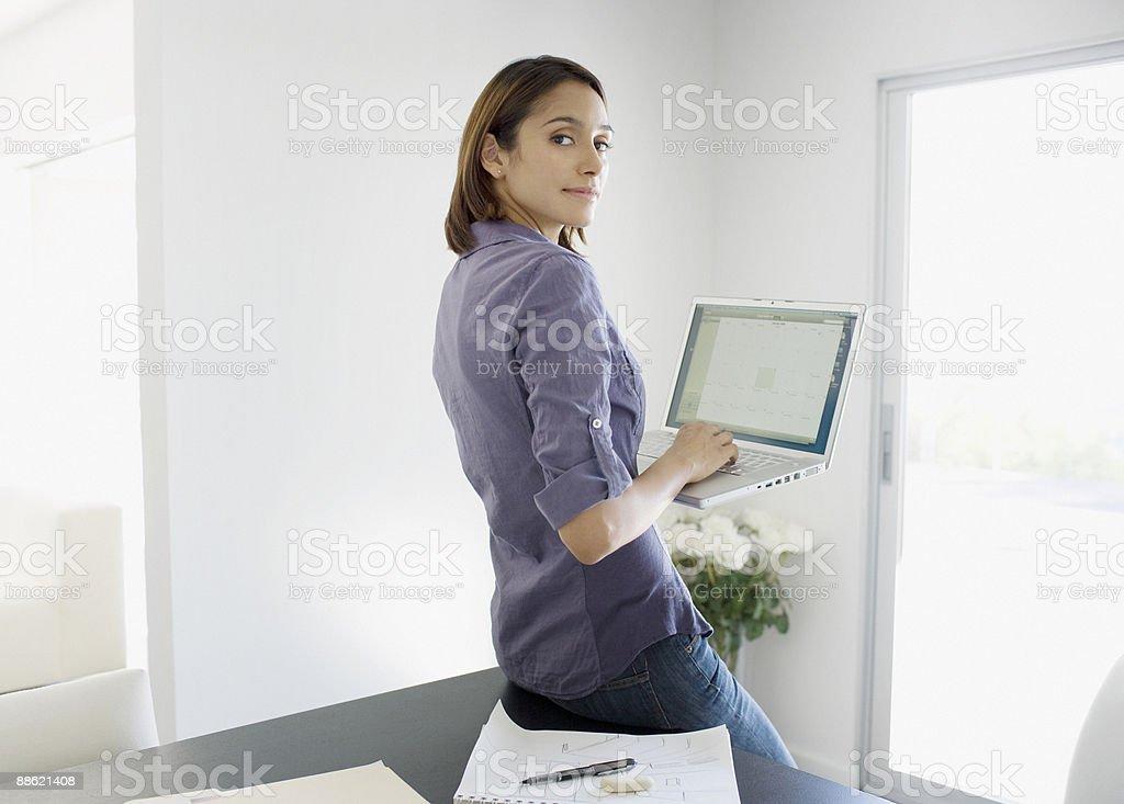 Woman using laptop at desk royalty-free stock photo