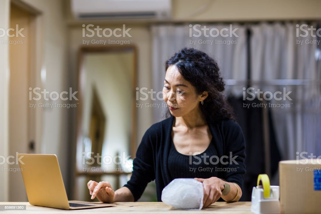 A woman using laptop at shop stock photo