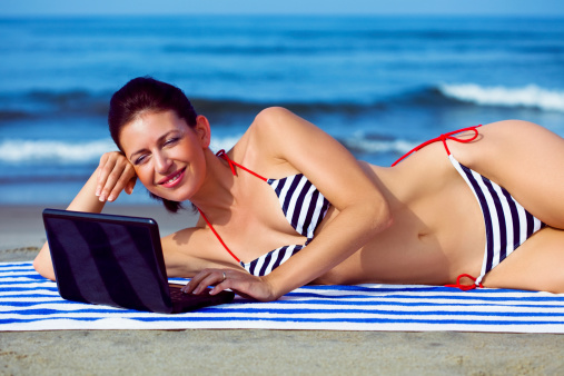 Woman Using Laptop At The Beach Stock Photo - Download Image Now