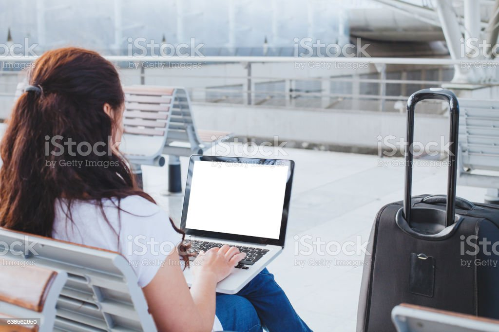 woman using laptop computer in airport, banking online or check-in stock photo