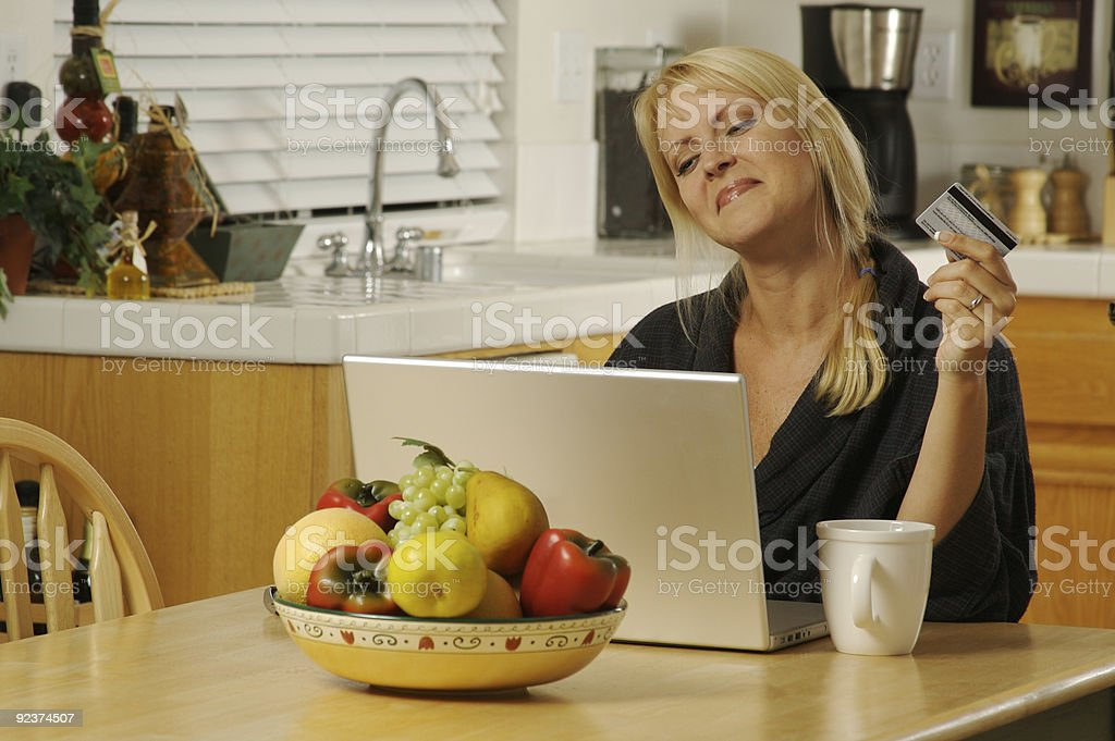 Woman Using Laptop for Ecommerce royalty-free stock photo