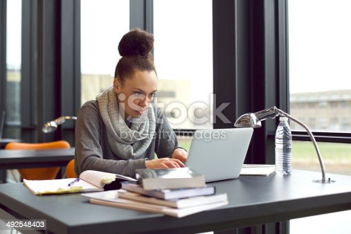 istock Woman using laptop for taking notes to study 492548403