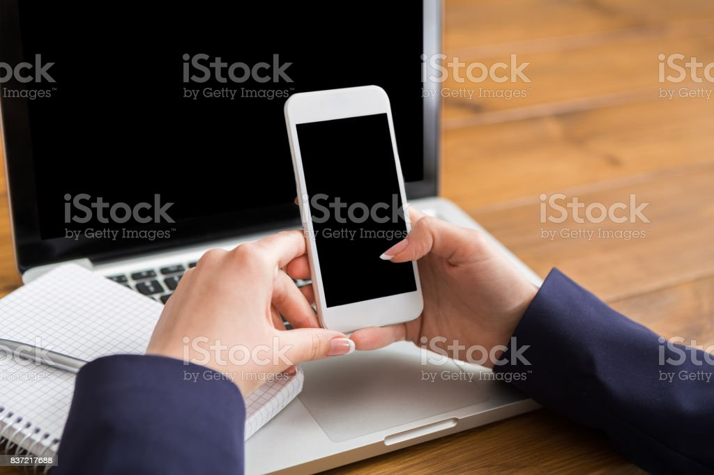 Woman using laptop in coffee shop, close-up stock photo