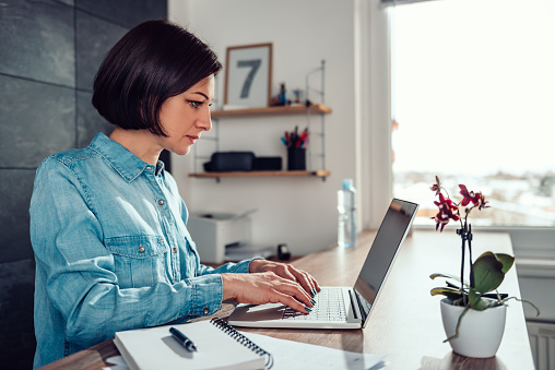 istock Woman using laptop in the office 1132308442