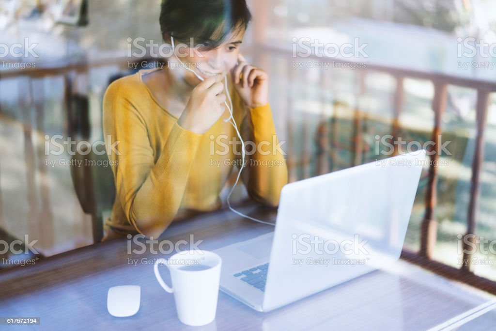 Woman using laptop, making video call stock photo