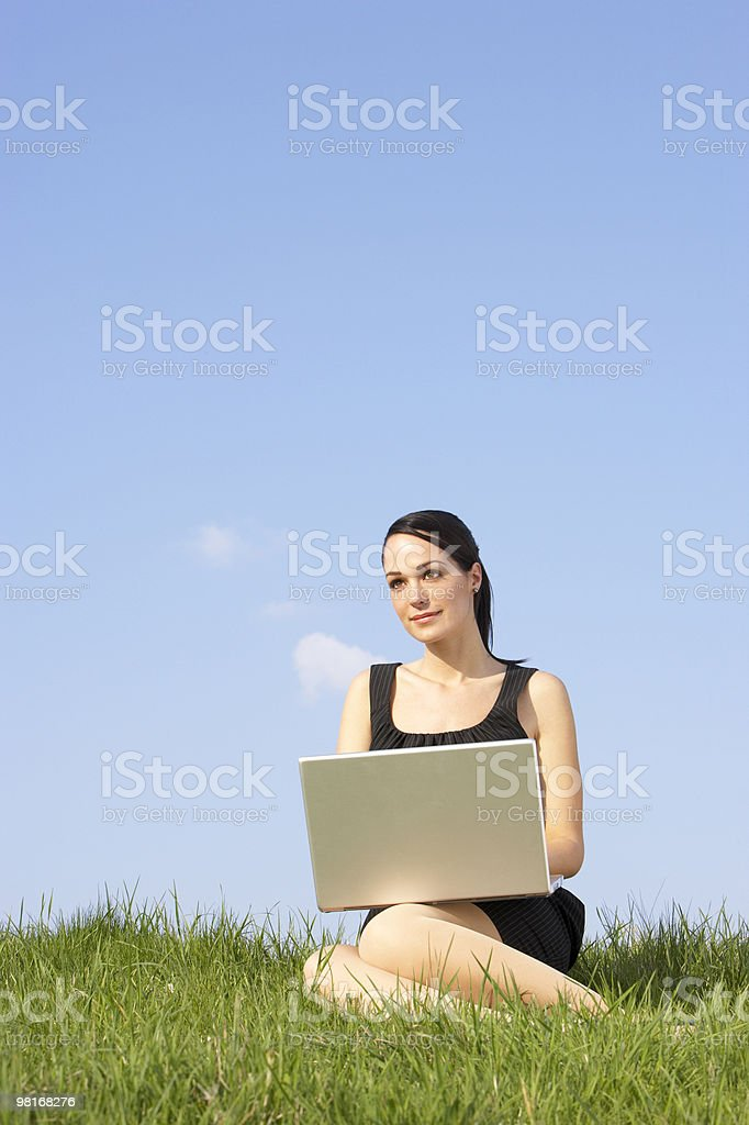 Woman Using Laptop Outdoors In Countryside royalty-free stock photo