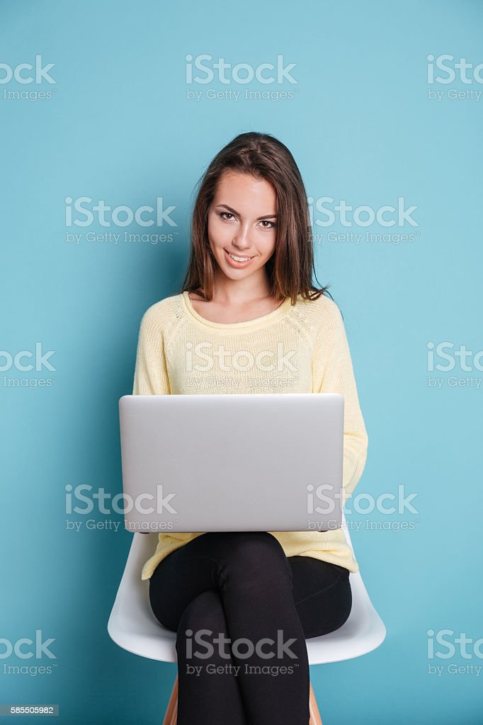 Woman using laptop pc computer over blue background stock photo