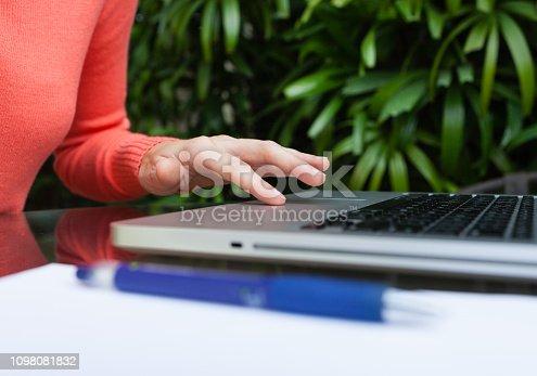 istock Woman using laptop 1098081832