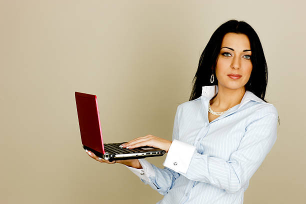 Woman using laptop Woman using laptop armenian ethnicity stock pictures, royalty-free photos & images