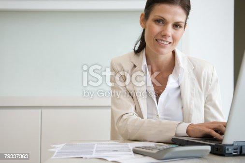 istock Woman using laptop 79337363