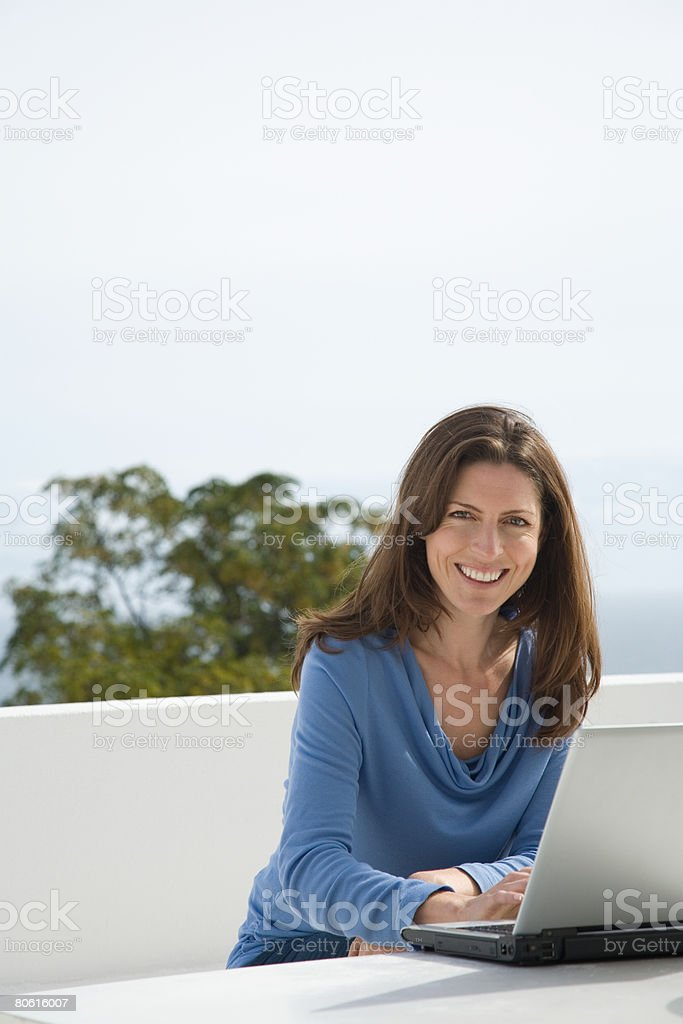 Woman using laptop royalty-free stock photo