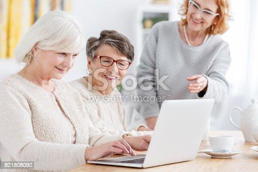 1053414472istockphoto Woman using laptop 821808092