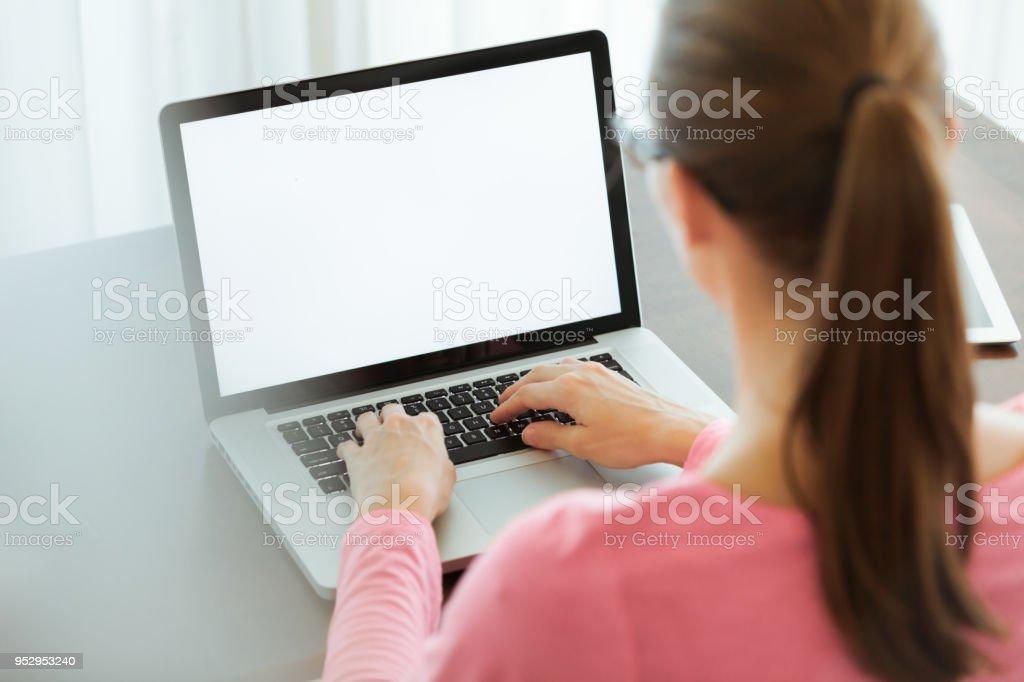 Woman using laptop stock photo