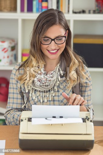 istock Woman Using Manual Typewriter 646725866
