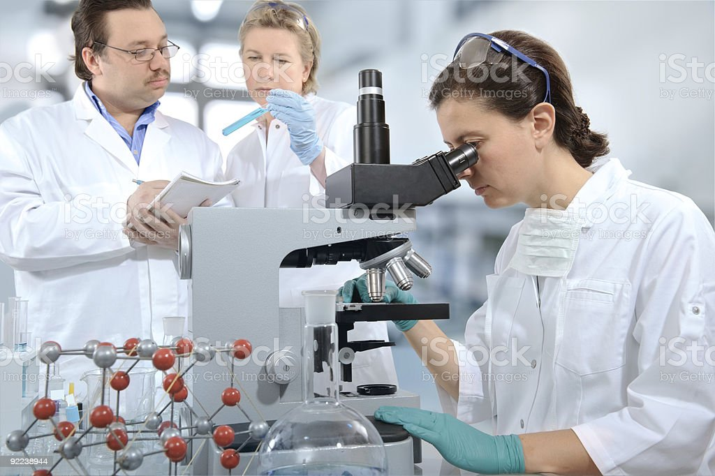Woman using microscope in laboratory  royalty-free stock photo