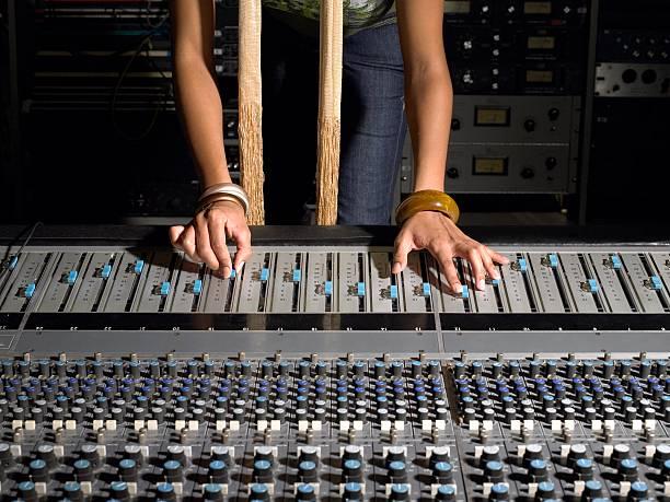 Woman using mixing desk stock photo