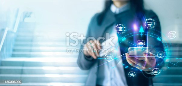 Woman using mobile payments. Digital marketing. Banking network. Online shopping and icon customer networking connection on virtual screen. Business technology concept.