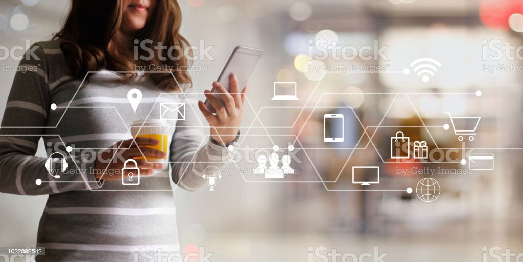 Woman using mobile payments online shopping and icon customer network connection. Digital marketing, m-banking and omni channel. stock photo
