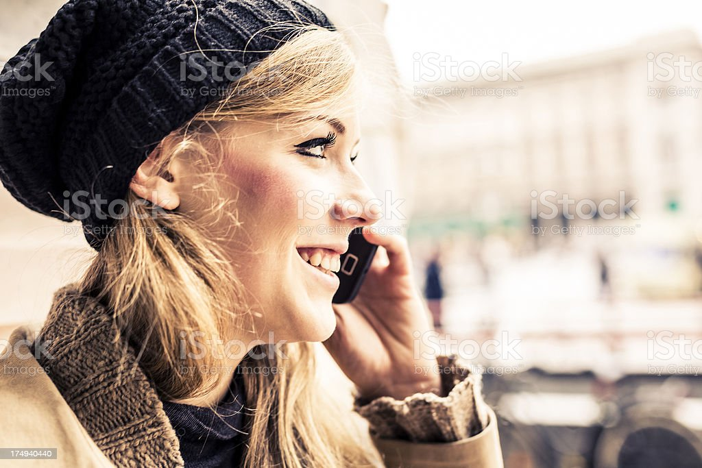 Woman using mobile phone outdoor royalty-free stock photo