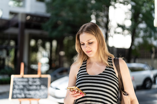 Woman Using Mobile Stock Photo & More Pictures of 30-34 Years