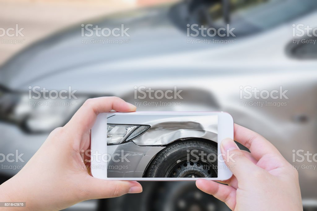 woman using mobile smartphone take photo car crash accident stock photo