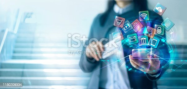 istock Woman using mobile smartphone with credit card  payments online shopping and icon customer network connection on virtual screen, digital marketing, online banking and business technology. 1150209334