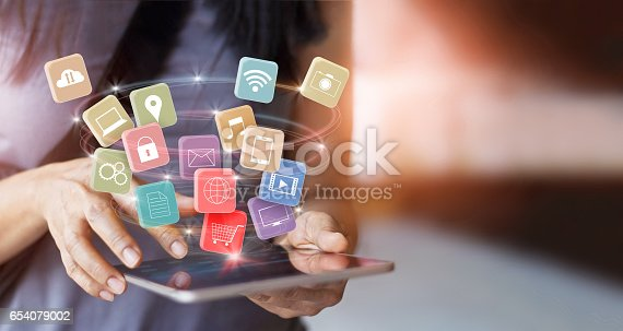 istock woman using mobile tablet payments online shopping and icon customer network connection on screen, pay all, m-banking and omni channel 654079002